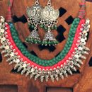 Green And Red Silk Treaded Dora Set In German Silver With Peacock Jhumki