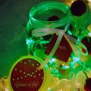 Candy Red and forest green pom pom lights in a jar