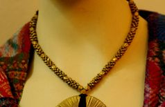 The India Craft House Dhokra Metal Necklace with Spiral Pendant