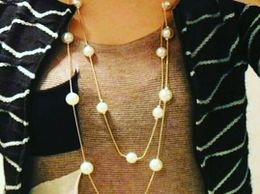 Double layered pearl Long Neck Statement