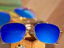 Gold and blue wayfarer style sunglasses for women 04379