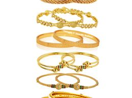 Jewels Galaxy Exclusive Combo of Gold Plated Plain, Meenakari, Kundan & Pearl Bangles - Combo of 6