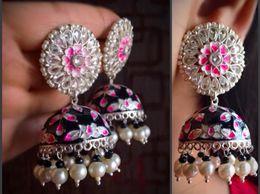 Designer big black hand painted jhumka with ad stone stud earrings