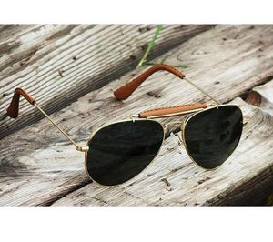 gold and black branded sunglasses 0298