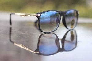 black  and blue sunglasses with free chokar