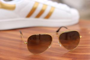 Golden and black stylish sunglasses 2712